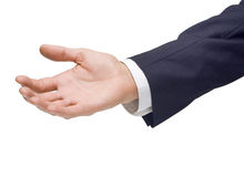 Business Man Hand Handout. A business mans hand being held out for help isolated on a white background Royalty Free Stock Images