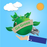 Business man hand hold the green world with city and country sid Royalty Free Stock Photography