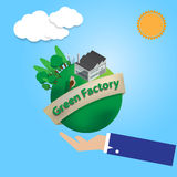 Business man hand hold the green world and factory safe Royalty Free Stock Photo