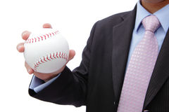 Business man hand holding baseball Stock Image