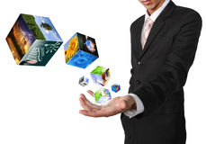 Business man hand holding with cube symbol image  industry image. And buildings image isolated on white Royalty Free Stock Image