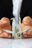 Hand holding origami paper cranes Royalty Free Stock Photo
