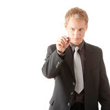 Business man hand holding pen. Writing on abstract screen isolated on white background Royalty Free Stock Images
