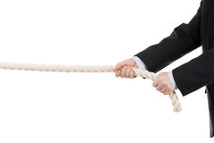 Business man hand holding or pulling rope Stock Image
