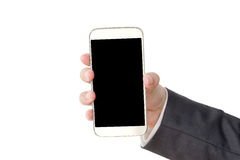 Business man hand holding smart phone isolated on white backgrou Stock Image