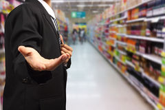 Business man hand holding in supermarket blurry Royalty Free Stock Image