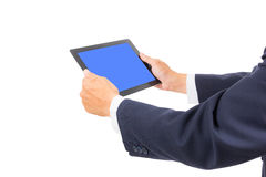 Business man hand holding tablet PC. Isolated Stock Photography