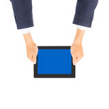 Business man hand holding tablet PC. Isolated Royalty Free Stock Photos