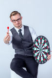 Business Man hand holding a target with darts hitting the center Stock Photos