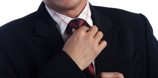 Business man Hand holding tie, white background, Royalty Free Stock Photo
