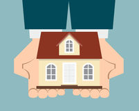 Business man hand holding up a house Stock Photography