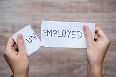 Free Business Man Hand Holding White Paper With The Text Unemployed Change Word To Employee. Positive Attitude, Crisis, Jobless And Royalty Free Stock Images - 182539409