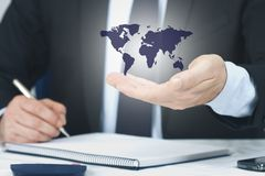 Hand with the international map royalty free stock photos