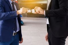 Business man hand making jigsaw and merging,Connecting together,Business thinking concept stock photos