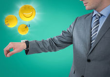 Business man with hand out and emojis with flares against teal background Royalty Free Stock Image