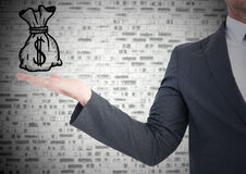 Business man with hand out and money doodle against grey brick wall Stock Photography