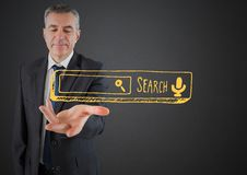 Business man hand out with yellow search bar against grey background Stock Photography
