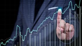 Business man hand point on business graph screen royalty free stock photos