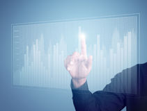 Business man hand pressing a chart Stock Photo