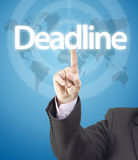 Business man hand pressing on deadline word Royalty Free Stock Photo