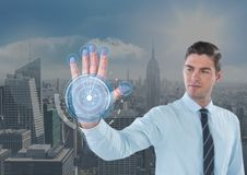 Business man with hand scan in front of the city Royalty Free Stock Images