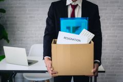 Business man hand sending resignation letter for stress from working. resign concept. Business man had sending resignation letter for stress from working royalty free stock image