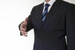 Business man hand shake. Business man gesturing a hand shake Stock Photography