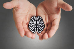 Business man hand show brain sign. As medical technology Royalty Free Stock Photo