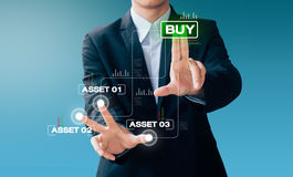 Business man hand sign about buy asset Stock Images
