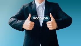Business man hand sign about good job Stock Photo
