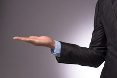 Business man hand sign in suit isolated stock photography