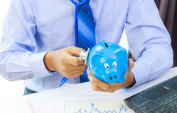 Business man hand with stethoscope checking piggy bank , financi Royalty Free Stock Photo