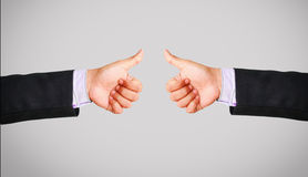 Business man hand in suit showing thumb up Stock Photo