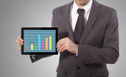Hand touch screen graph on a tablet Royalty Free Stock Photos