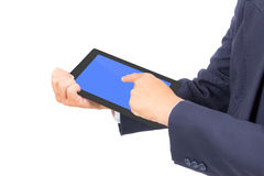 Business man hand touching tablet PC. Isolated Royalty Free Stock Photography