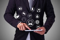 Business man Hand touching  tablet pc, social media concept.  Stock Photos