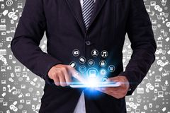 Business man Hand touching  tablet pc, social media concept. Business man Hand touching tablet pc, social media concept Royalty Free Stock Photography