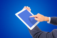 Business man hand touching white tablet PC Stock Photos