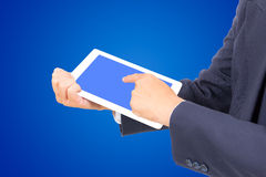 Business man hand touching white tablet PC Stock Photo