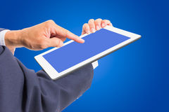 Business man hand touching white tablet PC Royalty Free Stock Photography