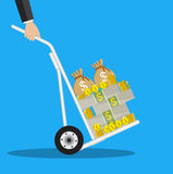 Business man with a hand truck full of money Royalty Free Stock Photography