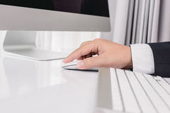 Business man hand using computer mouse Royalty Free Stock Image