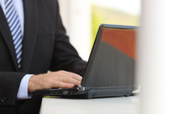Business man hand using a laptop in the street Stock Photography