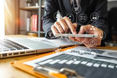 business man hand working with laptop computer, tablet and smart phone stock photo