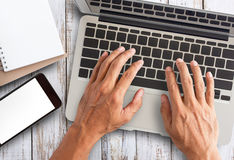 Business man hand working on laptop computer royalty free stock photography