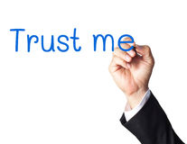 Business man hand writing trust me. On white background Stock Image