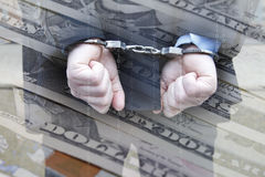 Business man in handcuffs. Dollar notes and data photomontage Stock Images