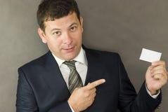 Business man handing a blank Stock Photo