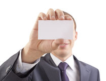Business man handing a blank. Business card over white background Royalty Free Stock Images