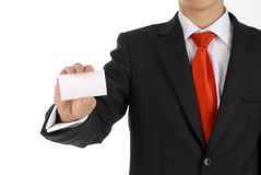 Business man handing a blank business card. The men holds blank business card which can contains information of you company royalty free stock images